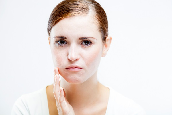 Young woman with toothache Feeling pain tooth
